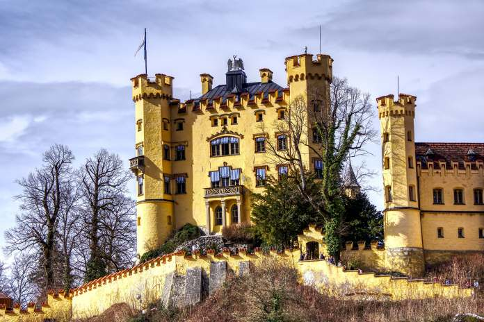 A worms eye view of the Hohenschwangau castle's front exterior.