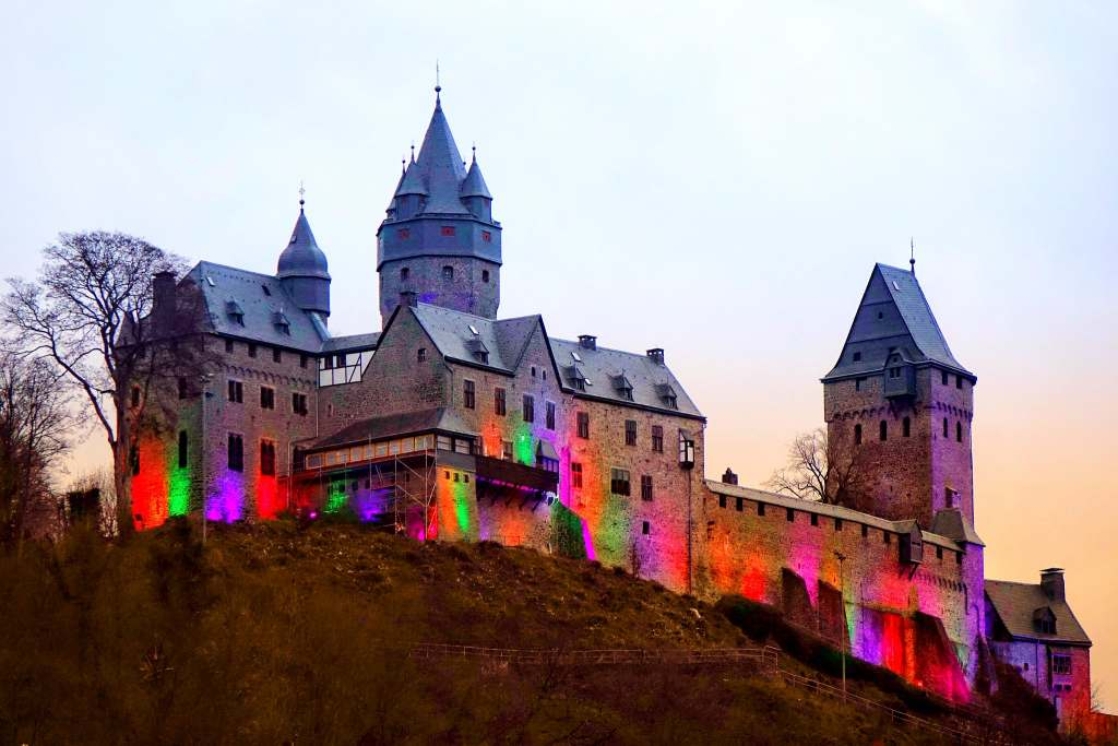Altena Castle during sunset in colorful exterior lighting.