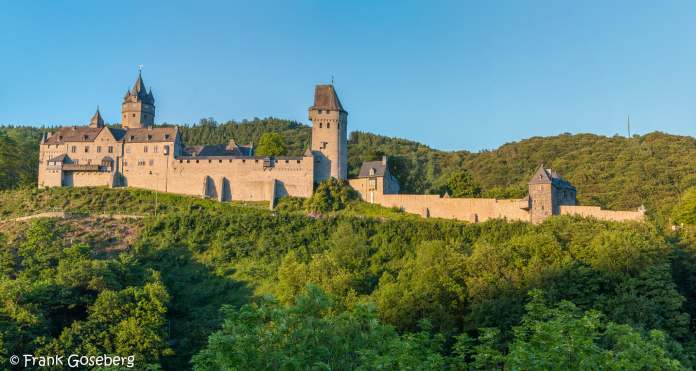 Altena Castle's beautiful view from afar surrounded by green trees
