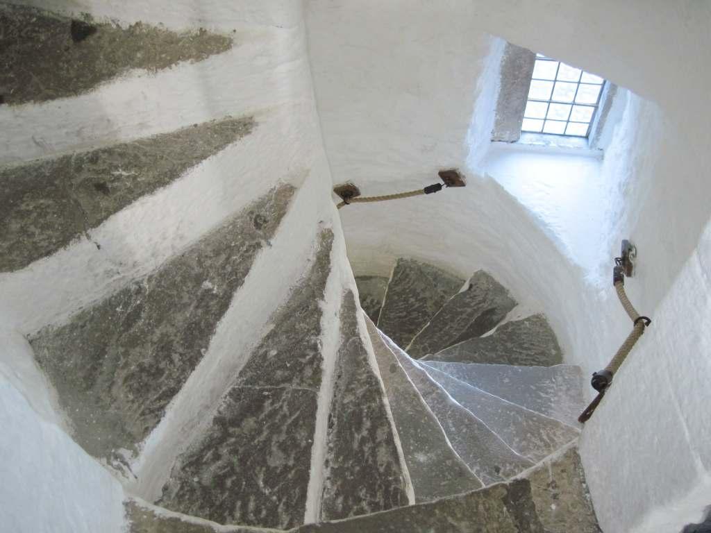 Spiral white staircase inside Cahir castle.