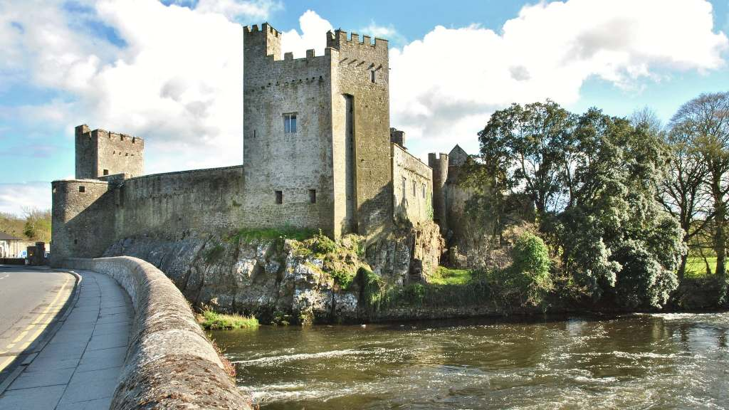 A beautiful view of Cahir castle's exterior from across the river.