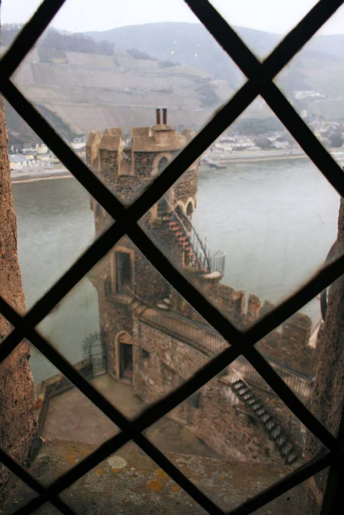 An inside view of the Rheinstein castle and the river from the window.