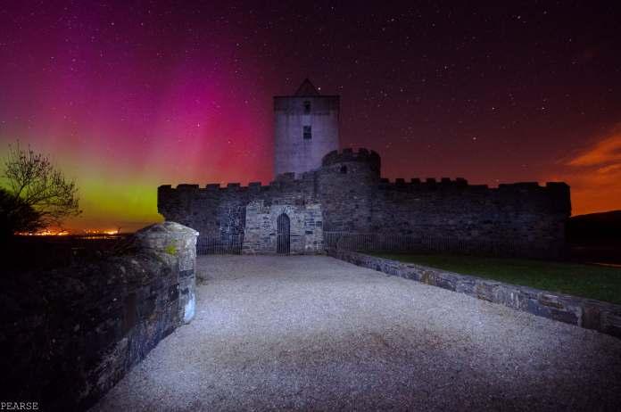 The beautiful Aurora Borealis over Doe Castle in Ireland.