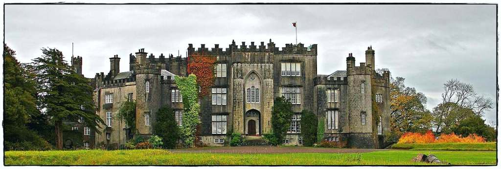 The best front view of the stunning Birr Castle with a huge green field in front of it.