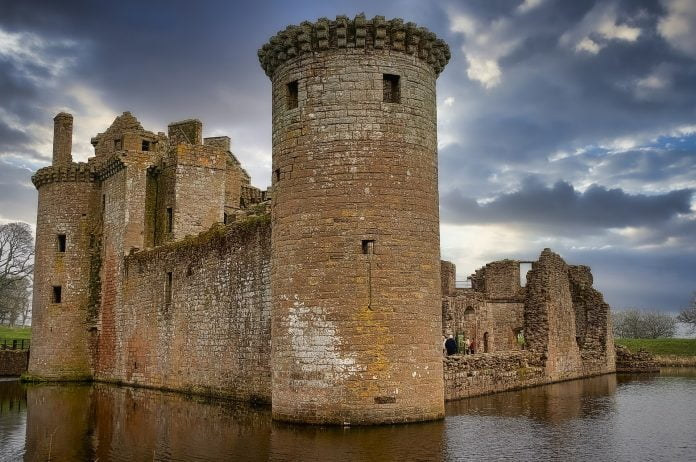 The triangular plan and surrounding moat of the Caerlaverock Castle