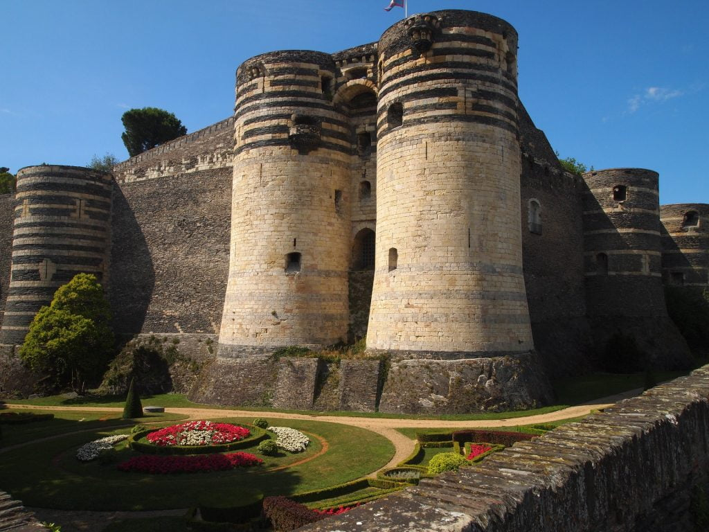 A look at the formidable structure of Chateau d'Angers with the garden.