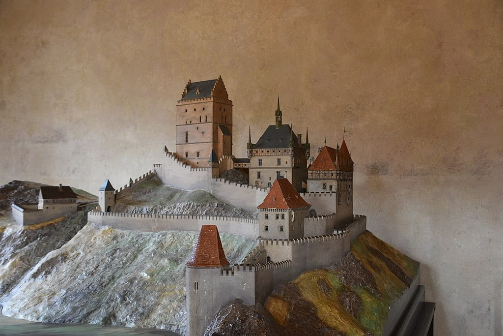 A scaled model of Karlštejn Castle and a closer look at its mountainous geography.