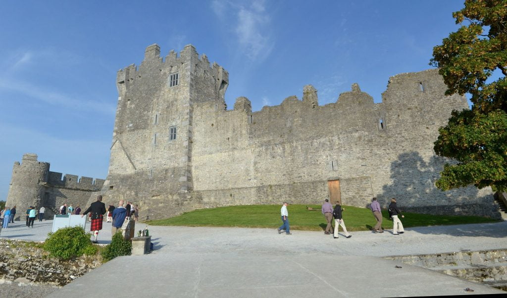 Ross Castle surrounded by tourists outside.