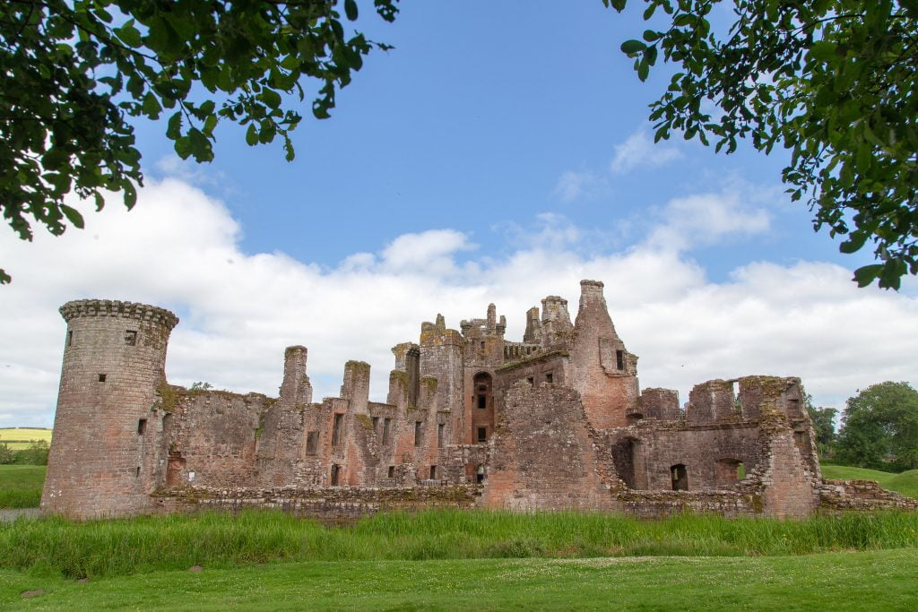 A look at the crumbling architecture of the castle and its green surroundings.
