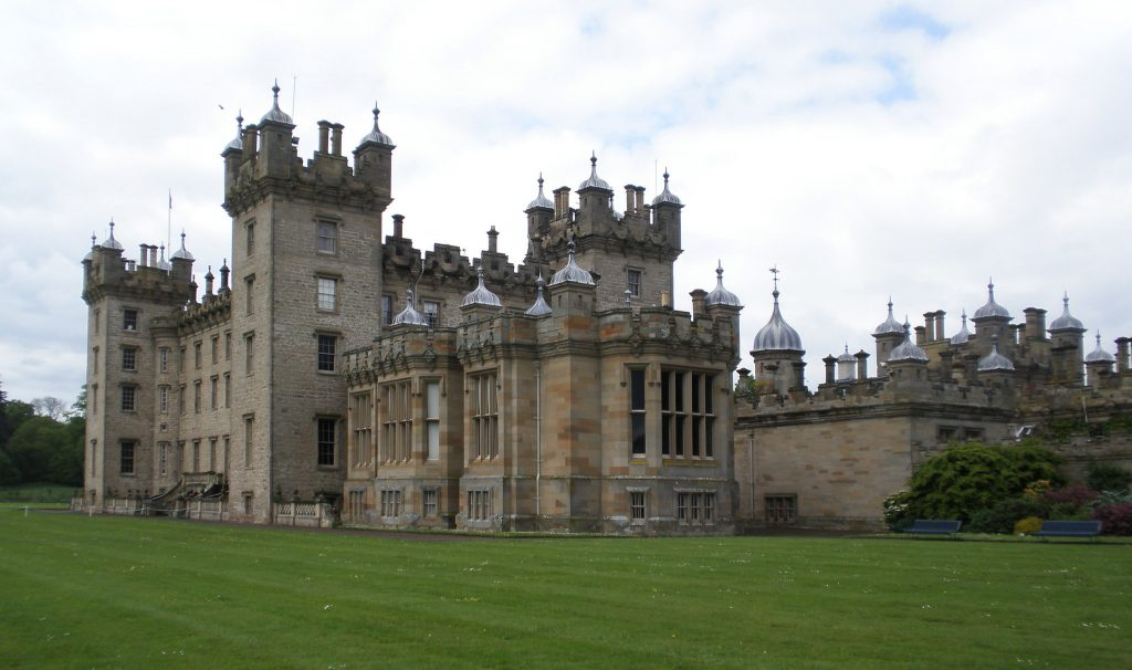 Floors castle surrounded by green grasses.