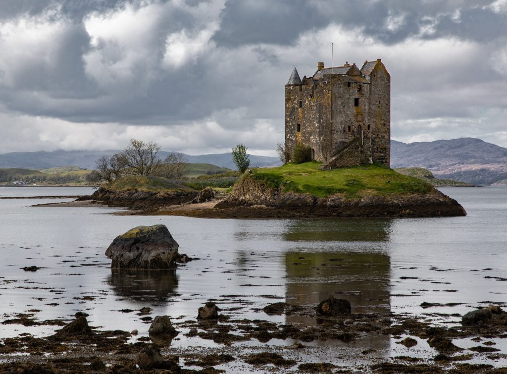 A picturesque view of the Castle Stalker from afar.
