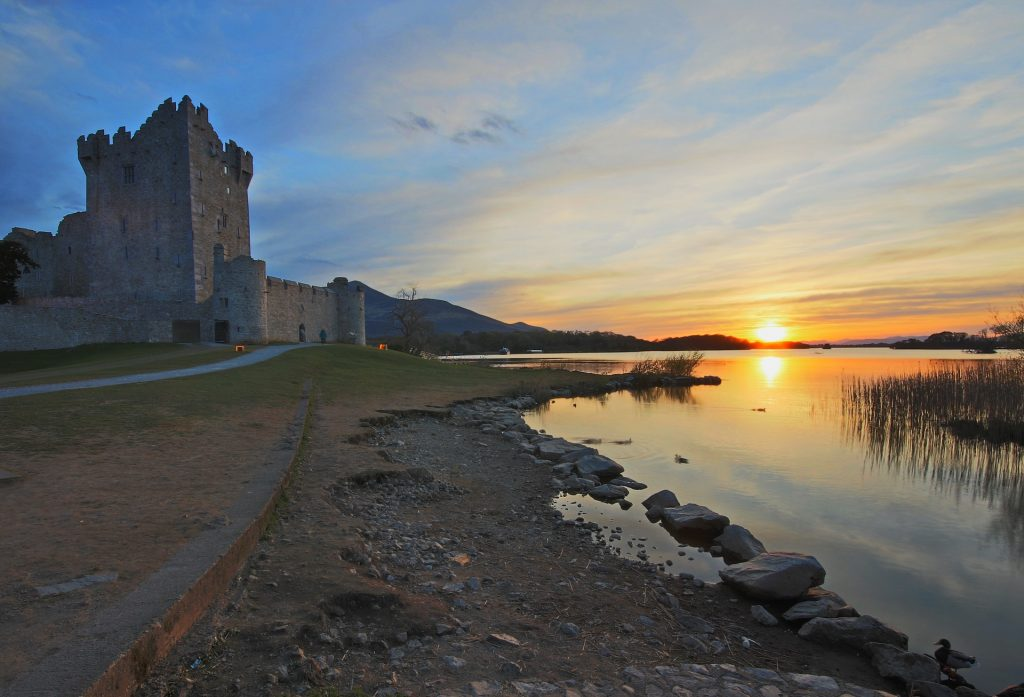 The beautiful sunset view of ross castle beside the river.