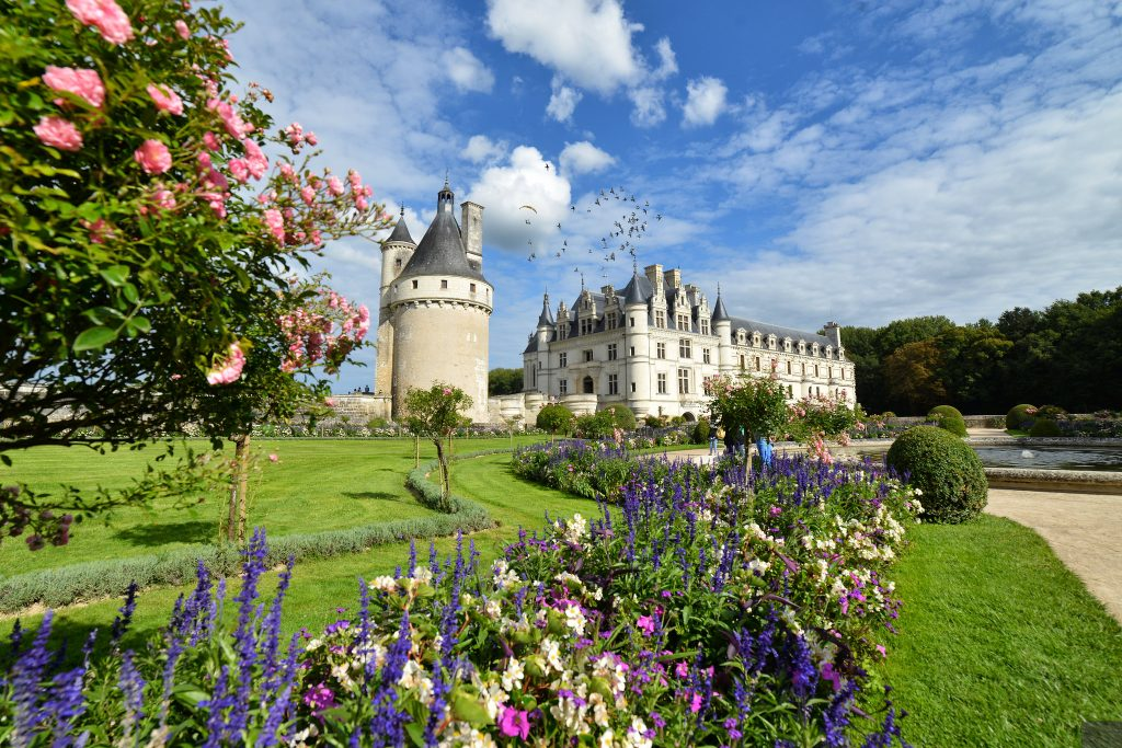 Worm's eye view of Château de Chenonceau behind the flowers.