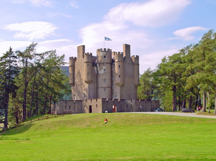 Braemar Castle surrounded by greens.