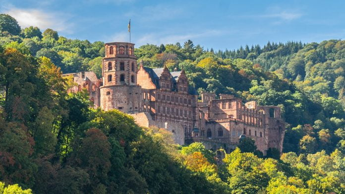 Heidelberg Castle view surrounded by green trees.