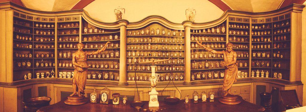Heidelberg's Castle interior museum with shelf full of pharmaceutical artifacts,