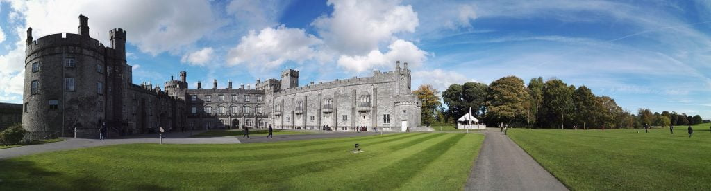 A wide-frame shot of Kilkenny's present facade with green surroundings.